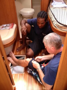 Simon and Dorsett troubleshooting the malfunctioning depth sounder