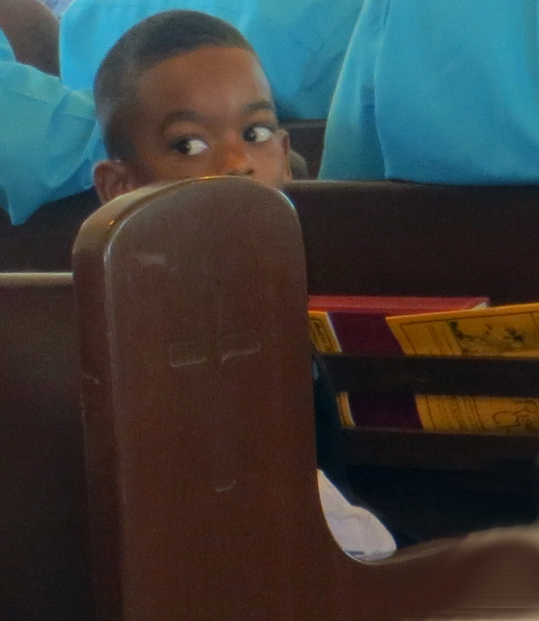 Boy in church pew