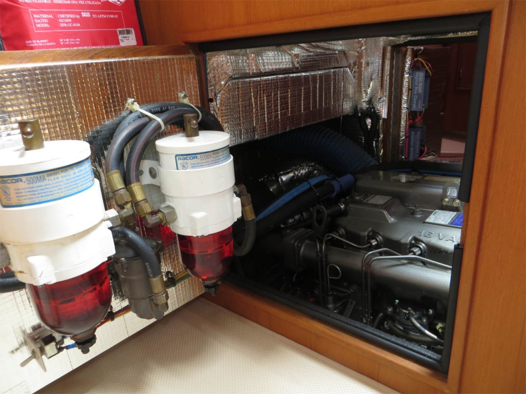 Racor filters for engine and genset mounted on hinged engine room door in galley
