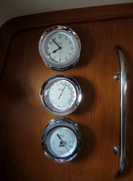 Weems & Plath Atlantis clock, thermometer and barometer mounted on bulkhead in salon