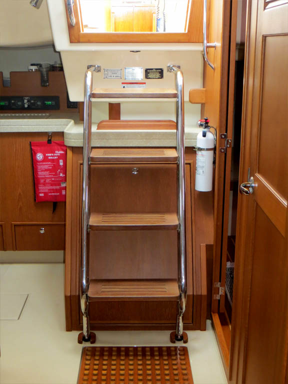 companionway stairs with engine access panel behind
