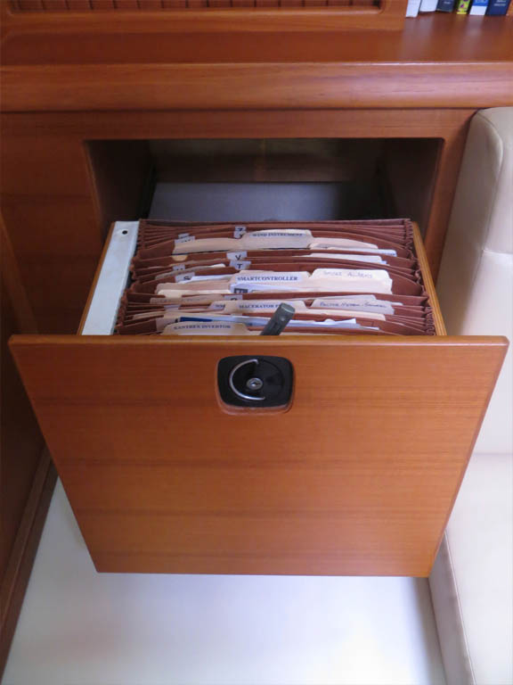 sliding, lockable file cabinet behind stbd. settee cushion