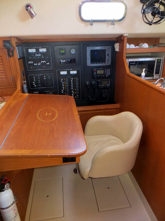 nav table with IP inlay, hydraulic rotating chair and nav station with storage bins below