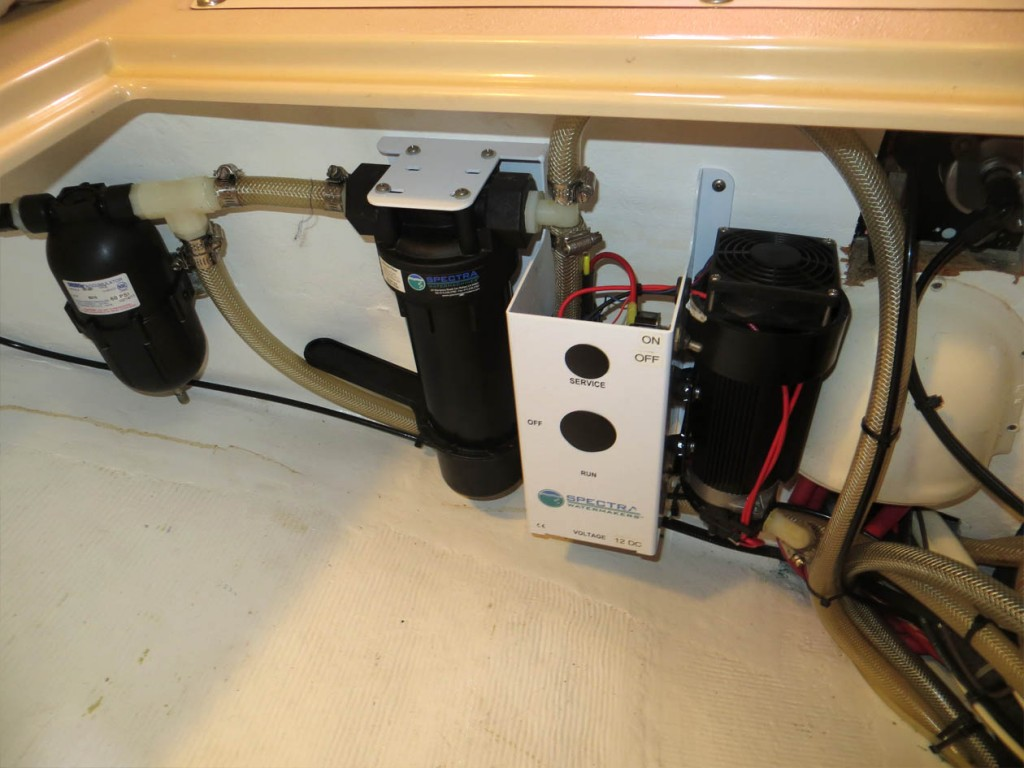 water maker 5 micron pre-filter and feed pump #2 mounted in storage bin under aft stateroom berth
