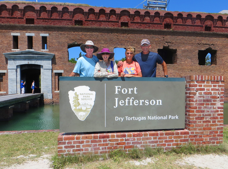 Four of us at Ft Jeff sign
